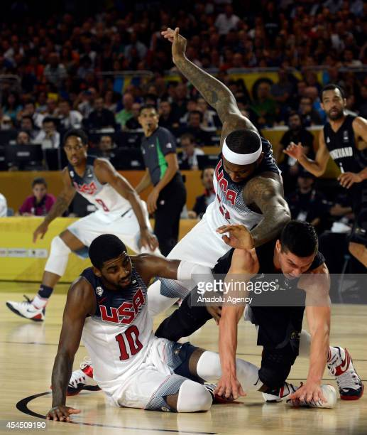 Kyrie Irving and DeMarcus Cousins of the USA in action against Jarrod Kenny of New Zealand during the 2014 FIBA Basketball World Cup Group C match...