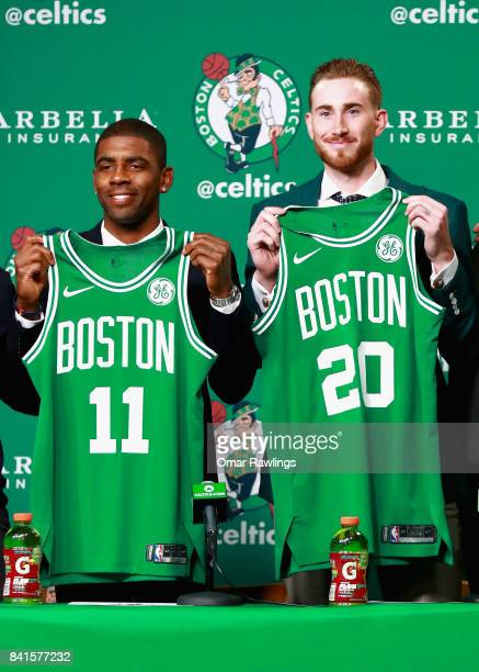 Kyrie Irving and Gordon Hayward hold up their jesrseys as they are introduced as the newest members of the Boston Celtics at TD Gardens on September...