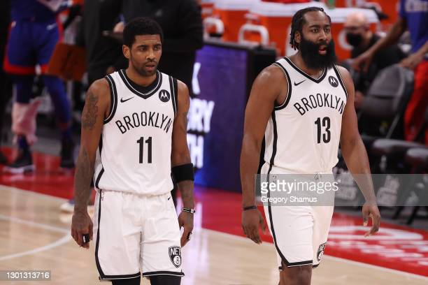 Kyrie Irving and James Harden of the Brooklyn Nets while playing the Detroit Pistons at Little Caesars Arena on February 09, 2021 in Detroit,...