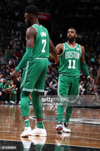 Kyrie Irving and Jaylen Brown of the Boston Celtics high five during the game against the Brooklyn Nets on November 14 2017 at Barclays Center in...