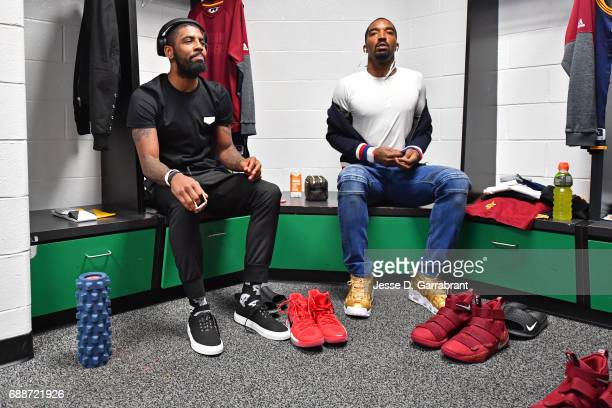 Kyrie Irving and JR Smith of the Cleveland Cavaliers get ready in the lockeroom before Game Five of the Eastern Conference Finals against the Boston...
