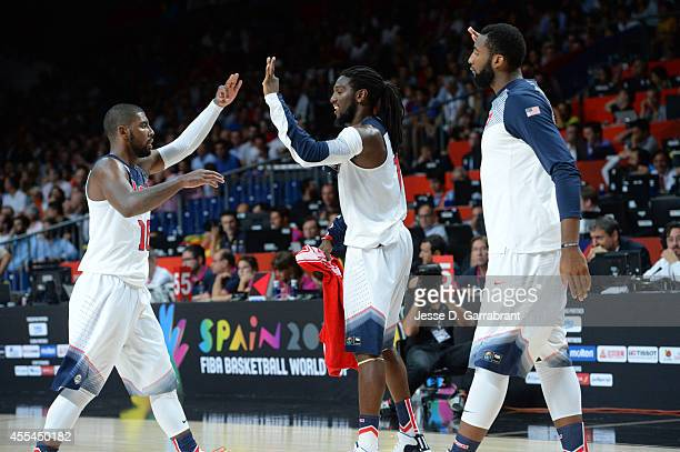 Kyrie Irving and Kenneth Faried of the USA Men's National Team celebrates against the Serbia National Team during the 2014 FIBA World Cup Finals at...