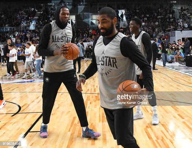 Kyrie Irving and Kevin Durant of Team LaBron laugh during practice for the 2018 NBA AllStar game at the Verizon Up Arena at LACC on February 17 2018...