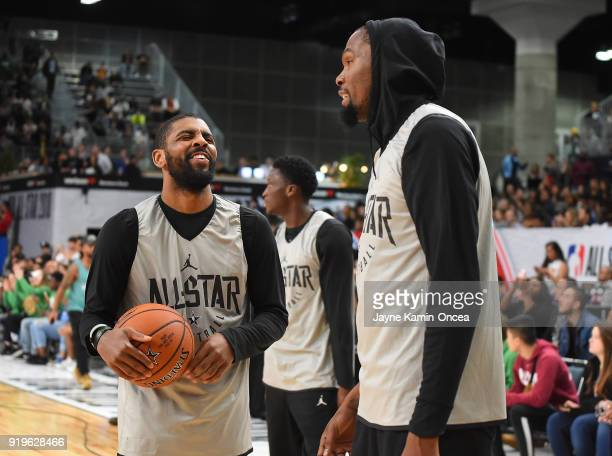 Kyrie Irving and Kevin Durant of Team LaBron laugh during practice for the 2018 NBA All-Star game at the Verizon Up Arena at LACC on February 17,...