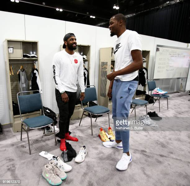 Kyrie Irving and Kevin Durant of Team LeBron sit in the lockerroom prior to the NBA AllStar practice as part of the 2018 NBA AllStar Weekend on...