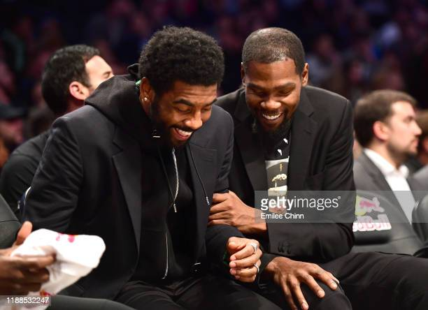 Kyrie Irving and Kevin Durant of the Brooklyn Nets laugh together on the bench during a game against the Indiana Pacers at Barclays Center on...