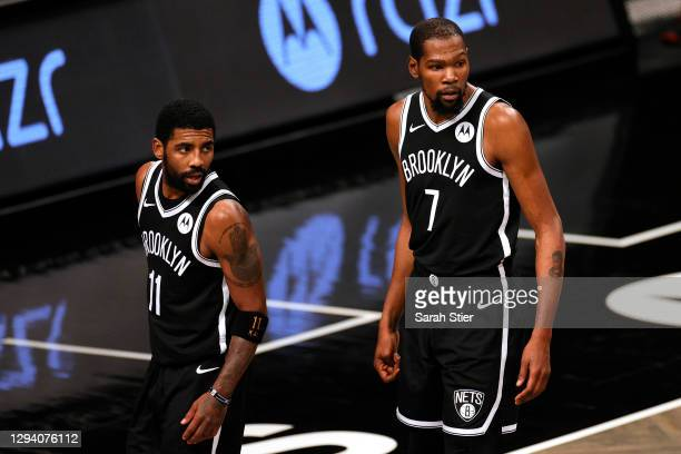 Kyrie Irving and Kevin Durant of the Brooklyn Nets look on during the second half against the Atlanta Hawks at Barclays Center on January 01, 2021 in...