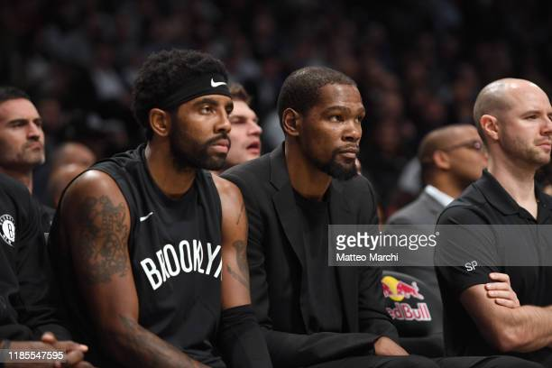 Kyrie Irving and Kevin Durant of the Brooklyn Nets react during the game against the New Orleans Pelicans at Barclays Center on November 04 2019 in...
