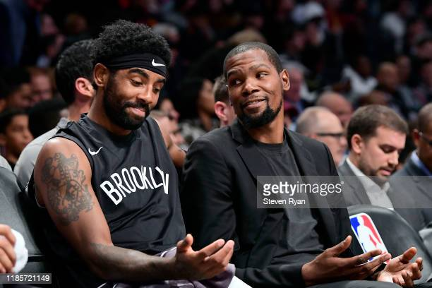 Kyrie Irving and Kevin Durant of the Brooklyn Nets speak on the bench against the Houston Rockets at Barclays Center on November 01, 2019 in New York...