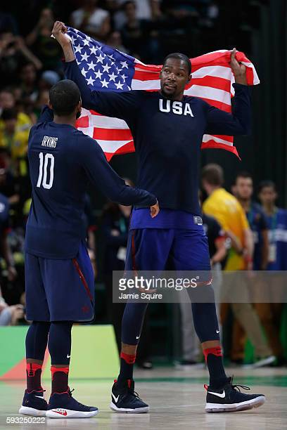 Kyrie Irving and Kevin Durant of United States celebrate after defeating Serbia during the Men's Gold medal game on Day 16 of the Rio 2016 Olympic...