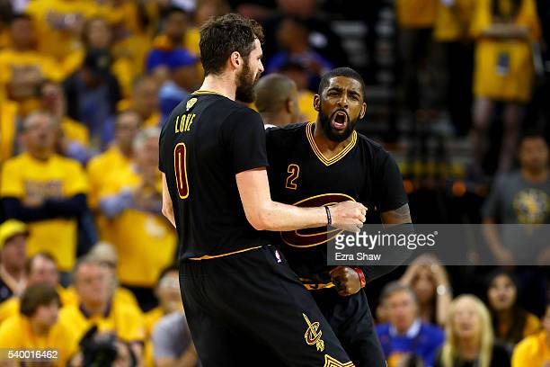 Kyrie Irving and Kevin Love of the Cleveland Cavaliers react in the fourth quarter while taking on the Golden State Warriors in Game 5 of the 2016...