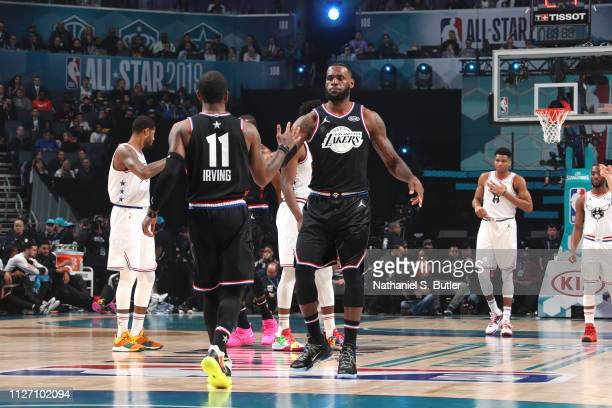 Kyrie Irving and LeBron James of Team LeBron highfive during the 2019 NBA AllStar Game on February 17 2019 at the Spectrum Center in Charlotte North...