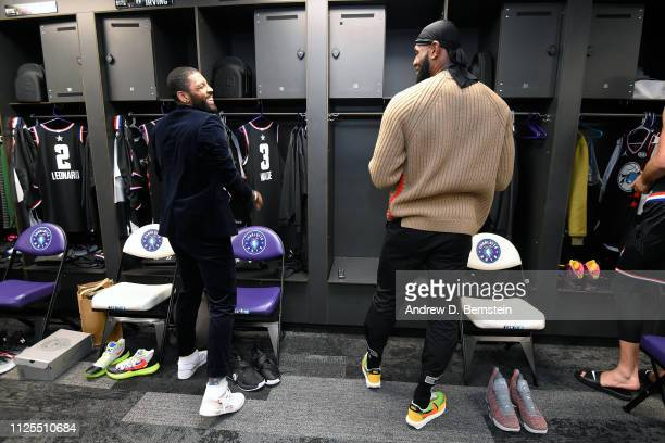 Kyrie Irving and LeBron James of Team LeBron talk before the 2019 NBA AllStar Game on February 17 2019 at the Spectrum Center in Charlotte North...