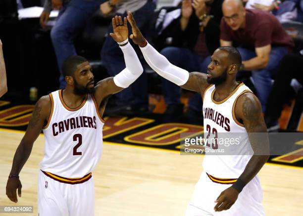 Kyrie Irving and LeBron James of the Cleveland Cavaliers celebrate after a play in the first quarter against the Golden State Warriors in Game 4 of...