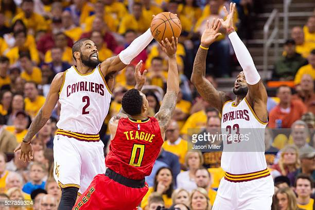 Kyrie Irving and LeBron James of the Cleveland Cavaliers guard Jeff Teague of the Atlanta Hawks during the first half of the NBA Eastern Conference...