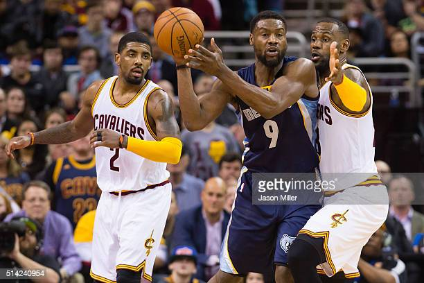 Kyrie Irving and LeBron James of the Cleveland Cavaliers guard Tony Allen of the Memphis Grizzlies during the second half at Quicken Loans Arena on...