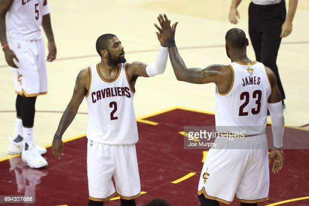 Kyrie Irving and LeBron James of the Cleveland Cavaliers high five during the game against the Golden State Warriors in Game Four of the 2017 NBA...