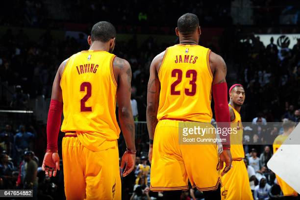 Kyrie Irving and LeBron James of the Cleveland Cavaliers looks on during the game against the Atlanta Hawks on March 3 2017 at Philips Arena in...
