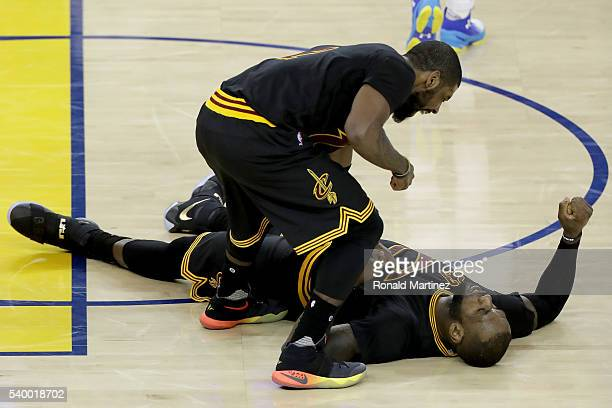 Kyrie Irving and LeBron James of the Cleveland Cavaliers react during the fourth quarter against the Golden State Warriors in Game 5 of the 2016 NBA...