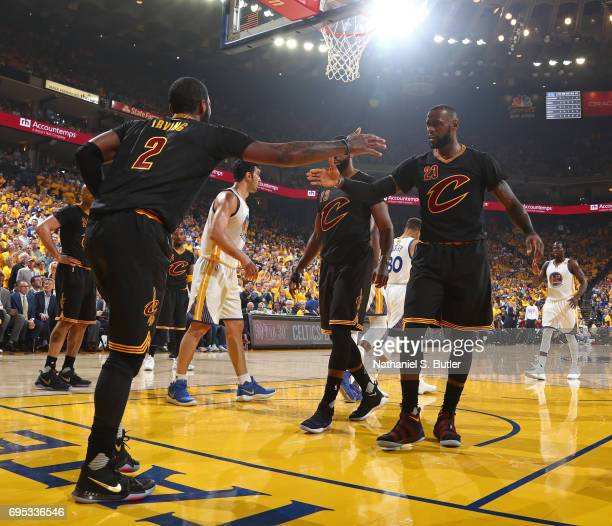 Kyrie Irving and LeBron James of the Cleveland Cavaliers shake hands in Game Five of the 2017 NBA Finals against the Golden State Warriors on June 12...