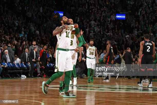 Kyrie Irving and Marcus Morris of the Boston Celtics react to a play during the game against the Toronto Raptors on January 16 2019 at the TD Garden...