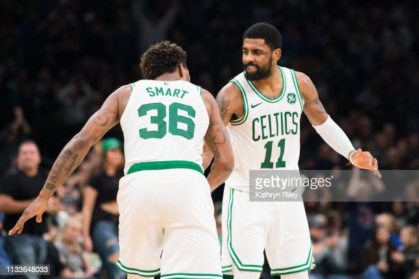 Kyrie Irving and Marcus Smart of the Boston Celtics celebrate during the game against the Indiana Pacers at TD Garden on March 29 2019 in Boston...