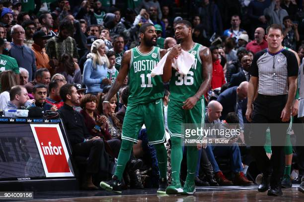 Kyrie Irving and Marcus Smart of the Boston Celtics look on during the game against the Brooklyn Nets on January 6 2018 at Barclays Center in...