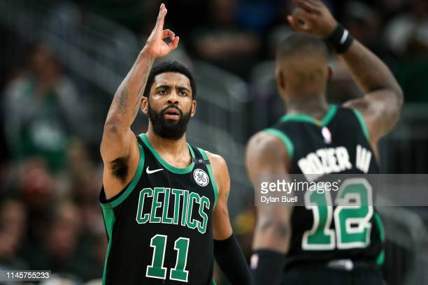 Kyrie Irving and Terry Rozier of the Boston Celtics celebrate in the fourth quarter against the Milwaukee Bucks during Game One of Round Two of the...