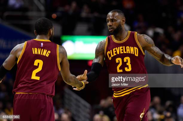 Kyrie Irving celebrates with LeBron James of the Cleveland Cavaliers after LeBron scored during the first half against the Minnesota Timberwolves at...