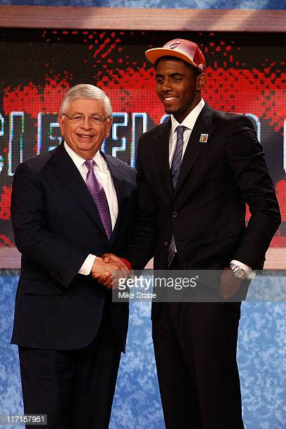 Kyrie Irving from Duke greets NBA Commissioner David Stern after he was selected number one overall by the Cleveland Cavaliers in the first round...