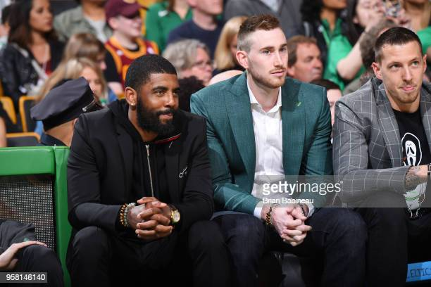 Kyrie Irving Gordon Hayward and Daniel Theis of the Boston Celtics look on during Game One of the Eastern Conference Finals of the 2018 NBA Playoffs...