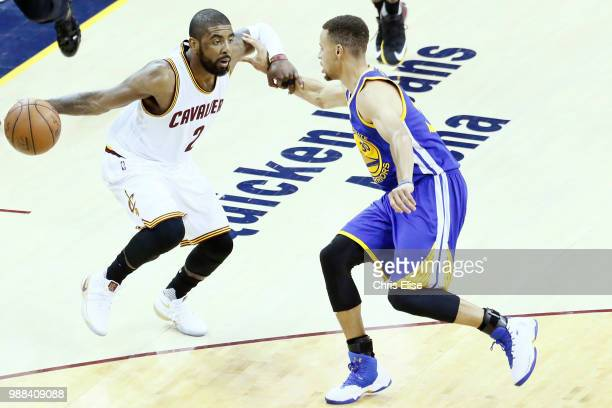 Kyrie Irving handles the ball against Stephen Curry of the Golden State Warriors during Game Three of the 2016 NBA Finals at the Quicken Loans Arena...