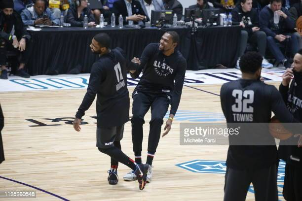 Kyrie Irving helps Kevin Durant of Team LeBron up during the 2019 NBA AllStar Practice Media Day presented by ATT on February 16 2019 at Bojangles...