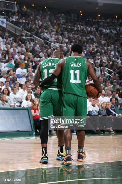 Kyrie Irving helps Terry Rozier of the Boston Celtics off the court during Game Two of the Eastern Conference Semifinals of the 2019 NBA Playoffs...