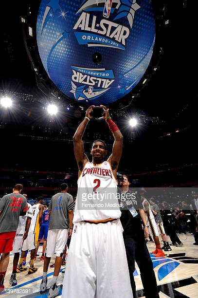 Kyrie Irving hoists his MVP trophy after the BBVA Rising Stars Challenge as part of 2012 AllStar Weekend at the Amway Center on February 24 2012 in...