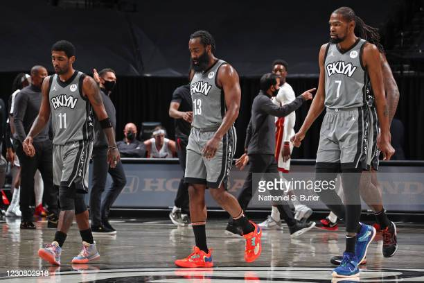 Kyrie Irving, James Harden and and Kevin Durant of the Brooklyn Nets walk off the court during the game against the Miami Heat on January 25, 2021 at...