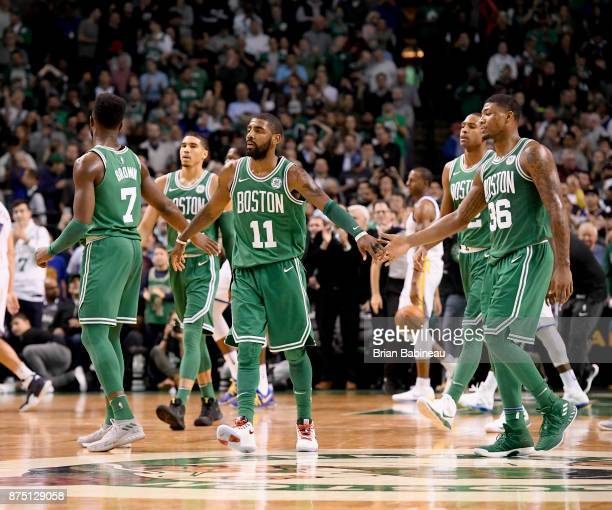 Kyrie Irving Jaylen Brown and Marcus Smart of the Boston Celtics high five after the game against the Golden State Warriors on November 16 2017 at...