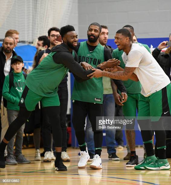 Kyrie Irving Jaylen Brown and Marcus Smart of the Boston Celtics reacts during practice as part of the 2018 NBA London Global Game at Citysport on...