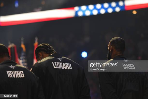 Kyrie Irving Kawhi Leonard and LeBron James of Team LeBron stand on the court for the National Anthem before the 2019 NBA AllStar Game on February 17...