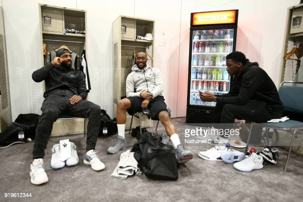 Kyrie Irving Kemba Walker and Victor Oladipo of Team LeBron sit in the lockerroom prior to the NBA AllStar practice as part of the 2018 NBA AllStar...