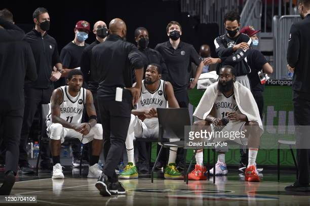 Kyrie Irving, Kevin Durant, and James Harden of the Brooklyn Nets huddle up during the game against the Cleveland Cavaliers on January 20, 2021 at...