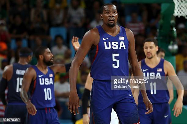 Kyrie Irving Kevin Durant and Klay Thompson of United States celebrate a play during the Men's Semifinal match against Spain on Day 14 of the Rio...