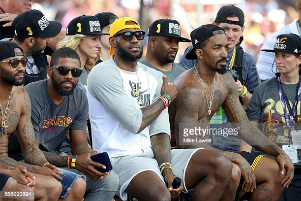 Kyrie Irving LeBron James and JR Smith of the Cleveland Cavaliers look on during the Cleveland Cavaliers 2016 NBA Championship victory parade and...