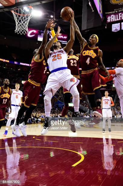 Kyrie Irving LeBron James Iman Shumpert of the Cleveland Cavaliers block Derrick Rose of the New York Knicks during the first half at Quicken Loans...