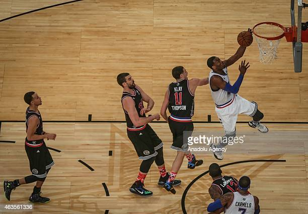 Kyrie Irving of Eastern Conference AllStar Team in action against Stephen Curry and Klay Thompson of Western Conference AllStar Team during the 64th...