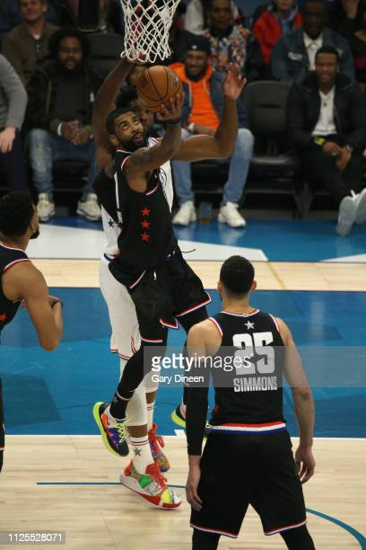 Kyrie Irving of Team Giannis shoots against Joel Embiid of Team Giannis during the 2019 NBA AllStar Game on February 17 2019 at the Spectrum Center...