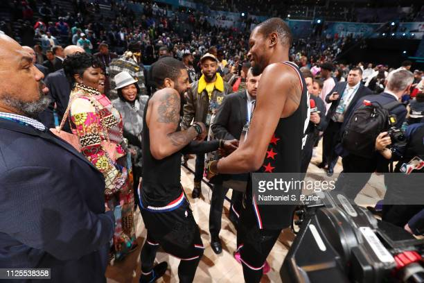 Kyrie Irving of Team LeBron and Kevin Durant of Team LeBron celebrate after the 2019 NBA AllStar Game on February 17 2019 at the Spectrum Center in...