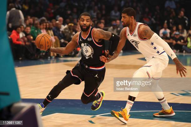 Kyrie Irving of Team LeBron drives to the basket against Paul George of Team Giannis during the 2019 NBA AllStar Game on February 17 2019 at the...