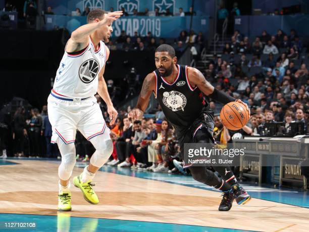Kyrie Irving of Team LeBron handles the ball against Stephen Curry of Team Giannis during the 2019 NBA AllStar Game on February 17 2019 at the...