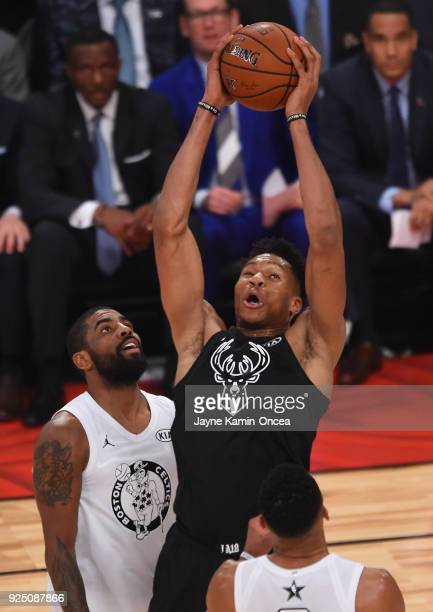 Kyrie Irving of Team LeBron looks on as Giannis Antetokounmpo of Team Stephen grabs a rebound during the NBA AllStar Game 2018 at Staples Center on...
